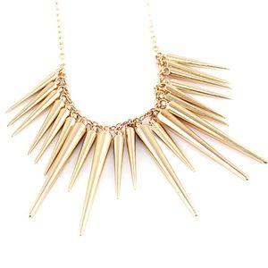A gold spike stament necklace